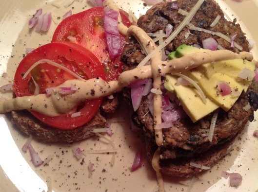 A remake of Candle79 black bean burger recipe with sunflower seeds and brown rice, slathered with Dijon, farmers market purple onion...avacado, parm and Roma tomatoes.