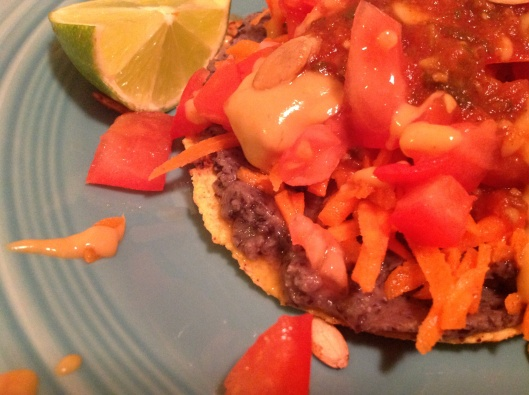 Sprouted corn tostada topped with the new vegan queso from Food for Lovers...then there's yummy carrots, tomatoes, salsa and spicy Tamari seeds...a lime for a squeeze or two.