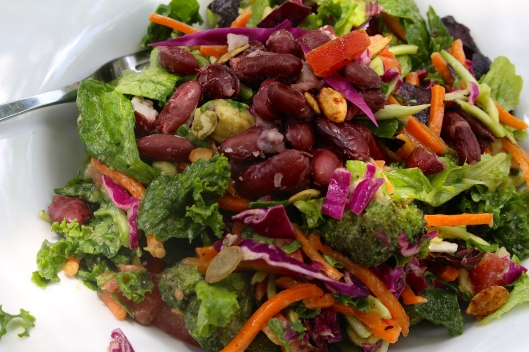 A good friend of mine always told me to strive for a 'rainbow' of colors in your salads. The one we made for lunch today had purple cabbage, carrots and a bunch of other healthy fixins.