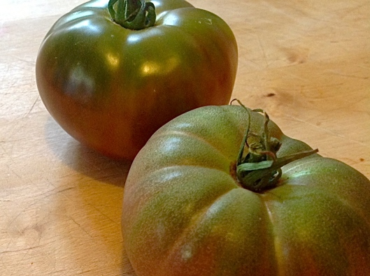 Heirloom tomato with shiny skin comes from Bat Farms in Bertram, TX (Top Growers). Mine of the same variety looks dull. Which makes sense. I am about to get a soil test.