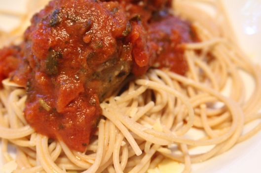Turkey sage meatballs and oat bran spaghetti pasta. (We were just like 'pigs in slop' tonight, really, slurping noises included.)