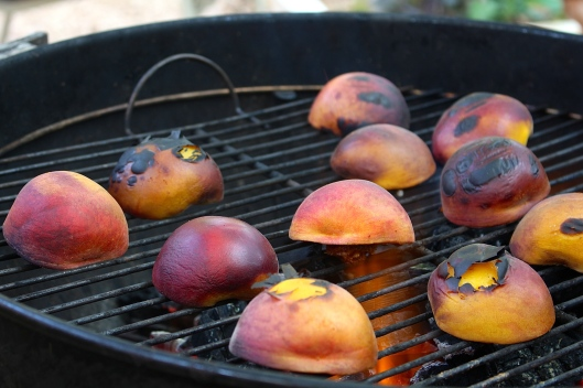 The peaches cook on both sides until the syrup starts appearing on the surfaces. (The fire was probably a little too hot, but the scorched skin comes off for the parfait.)