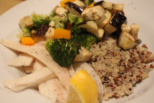 We ate a super healthy dinner -- dover sole with lemon -- topped with an eggplant, broccoli roasted salad -- and rainbow quinoa.