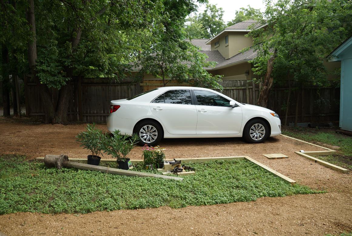 project backyard parking spot yard and plate