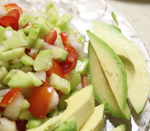She made everything from scratch. Here's a summer salad with fresh tomato, onion, cucumber, diced onion and a side of  avocado. We said 'this is a feast.' She said this is the way lunch is done in Iran. Big lunch, smaller dinner.