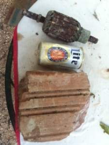 All the fun treasure found today in the 'cinder block' structure...a old beer can, a clay brick..and an old motor...you know...just 'backfill' for us country folk.