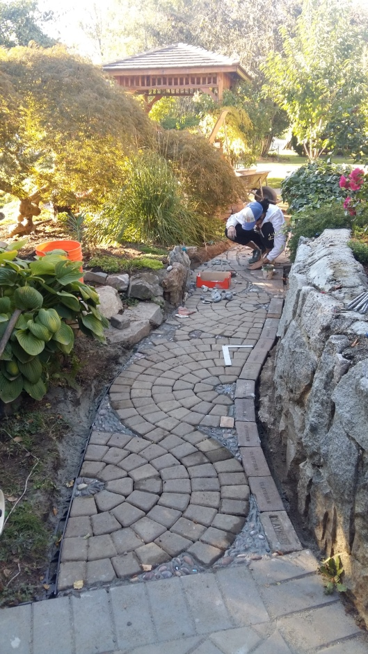 We thought we wouldn't have a chance to even lay the pavers on this side of the path...but we worked long hours toward the end of the week to see that we had a frame work we could at least see take shape.