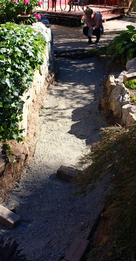 While we still have dirt to remove (on one part of the path) -- we are also beginning to spread granite as the very bottom base layer (at one of the entry points to the path).