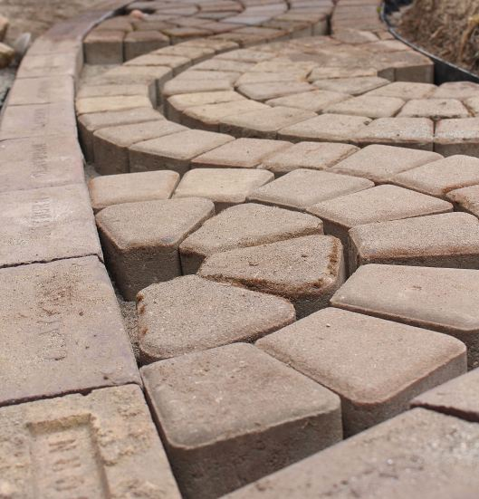 (Clayburn Village Bed and Breakfast, Abbotsford, B.C.) -- The rain prevented us from working on the brick path today. (This image is from Friday, when we worked on finally setting some of the pavers in place to create the 'wavy, curvy pattern.'