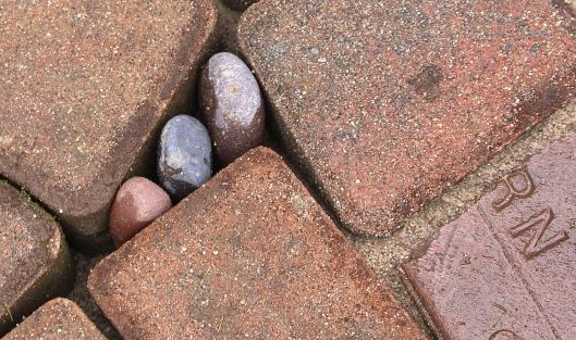 We had to research the kind of mortar we'll use to plug up the 'big gaps.' We'll be filling these with pebbles as well.