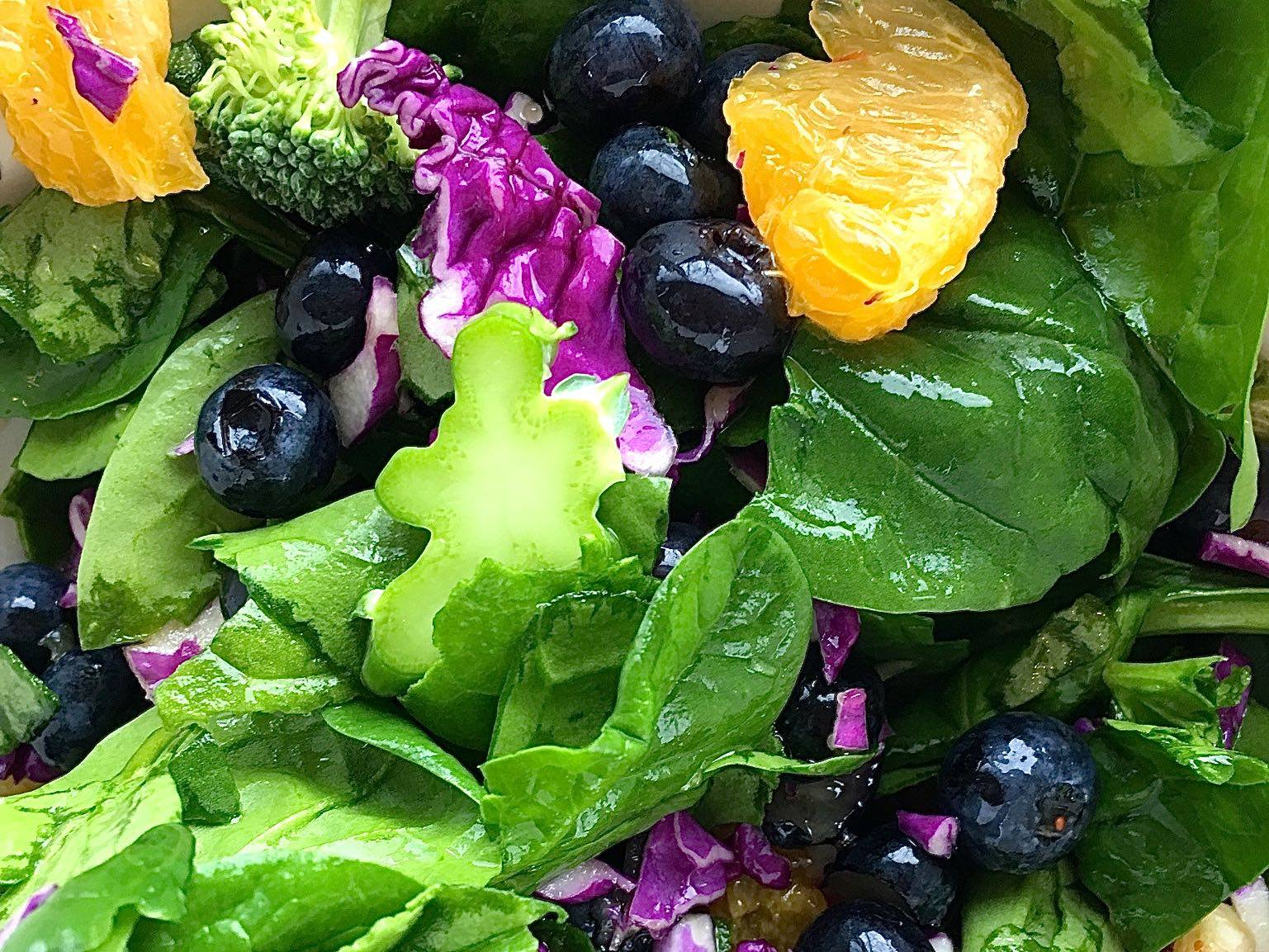 greens, orange, broccoli, purple cabbage
